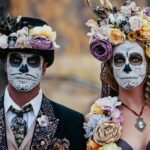 Man and woman in Dia De Los Muertos face paint